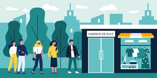 File d'attente de personnes en attente d'ouverture d'une sortie de mode à la mode