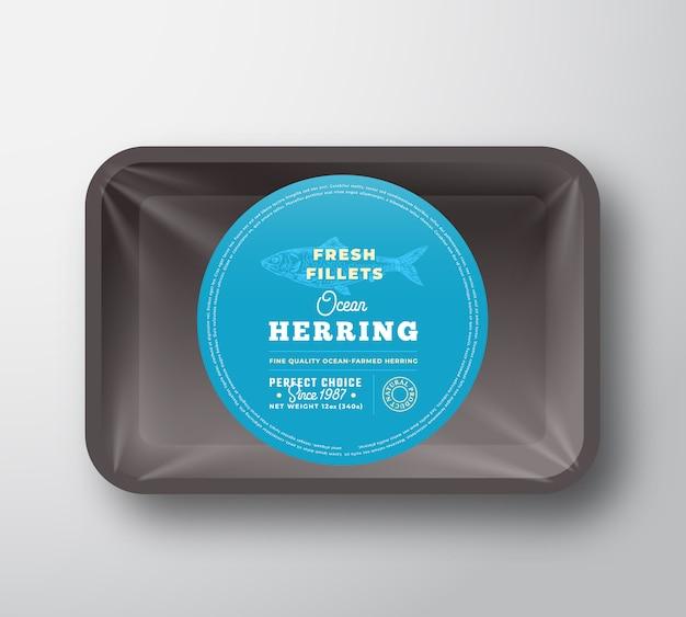 Filets de hareng de l'océan. plateau en plastique de poisson vecteur abstrait avec conception d'emballage de couverture de cellophane