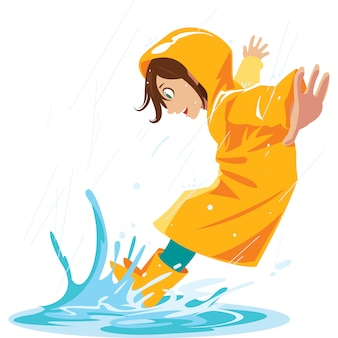 Fille aime piétiner dans les flaques de pluie en saison des pluies.
