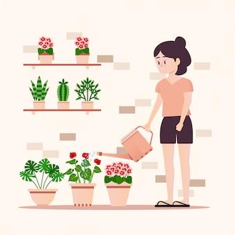 Fille arrosant des plantes
