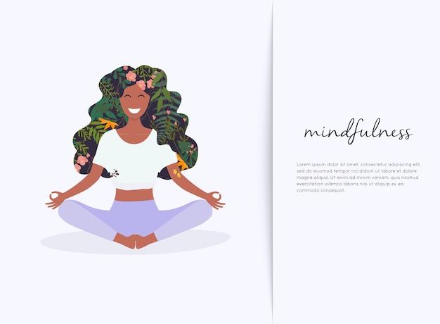 Fille aux cheveux de fleur en posture de lotus yoga