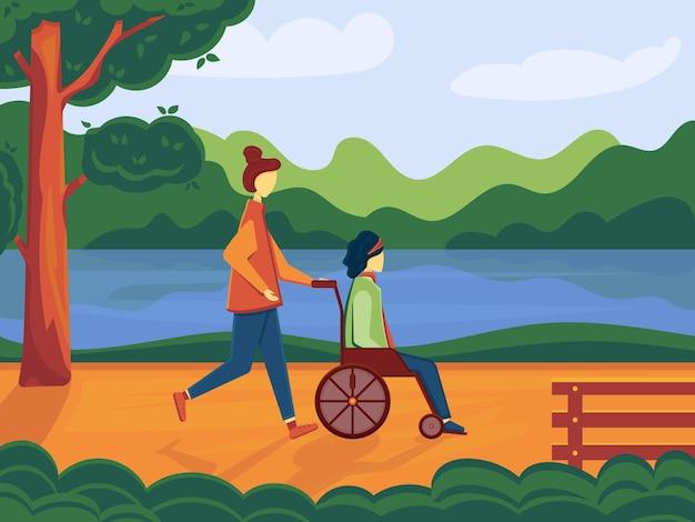 Fille bénévole marchant dans le parc avec une femme handicapée en fauteuil roulant