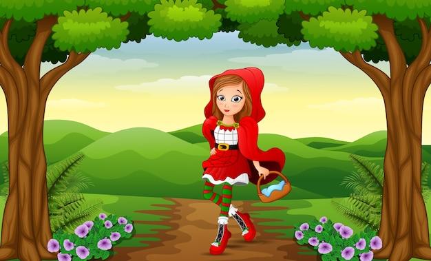 Fille à capuchon rouge sont dans le village à la forêt