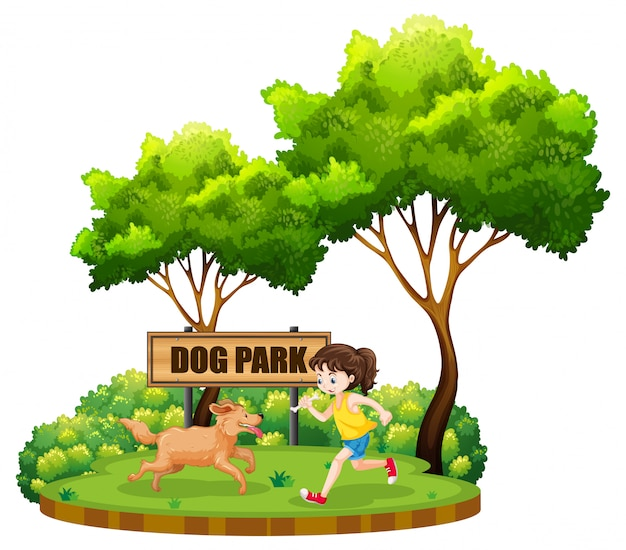 Une fille et un chien au parc à chiens