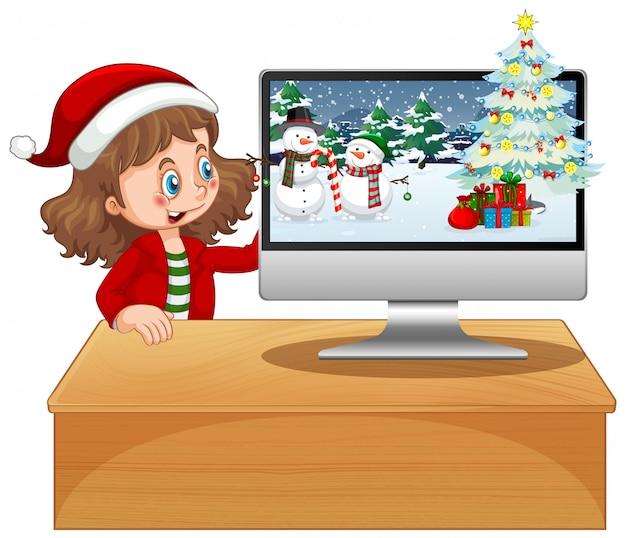 Fille à côté de l'ordinateur avec thème de noël