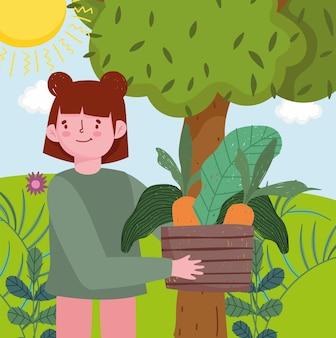 Fille cueillant des légumes dans un jardin