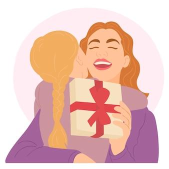 Fille donnant un cadeau à sa mère