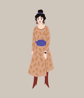 Fille élégante dans une robe avec un sac banane style street wear vêtements à la mode