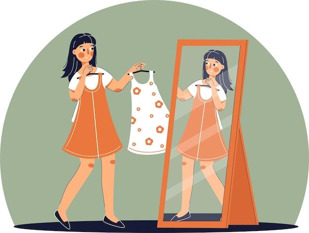 Fille essayant une robe dans un magasin de vêtements. achats