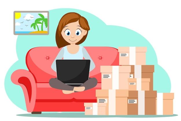 Une fille est assise sur un canapé avec un ordinateur portable et commande des marchandises avec livraison à domicile. commerce électronique