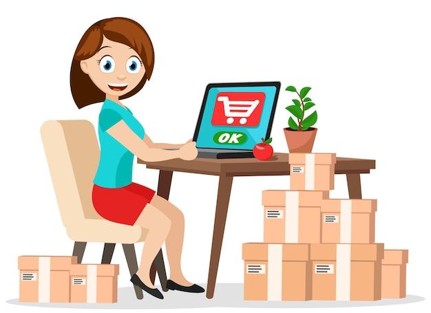 Une fille est assise à une table avec un ordinateur portable et commande des marchandises avec livraison à domicile. commerce électronique