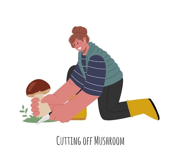 La fille est à genoux et coupe un champignon avec un couteautechniques de coupe