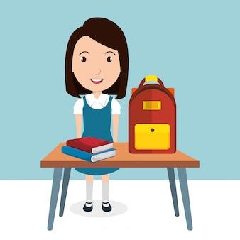 Fille avec des fournitures scolaires