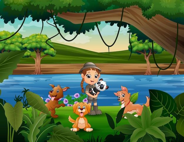 Fille heureuse de gardien de zoo avec l'animal dans la jungle