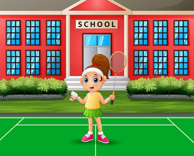 Fille heureuse, jouer au badminton à la cour de l'école