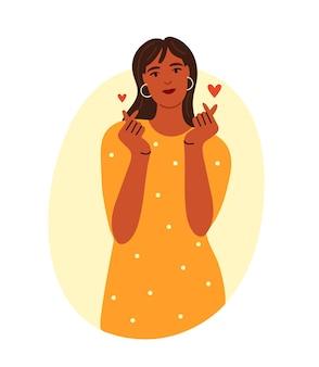 Une fille heureuse montre un kheart avec ses doigts illustration vectorielle plane