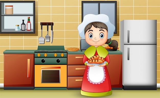 Fille heureuse portant un pain délicieux