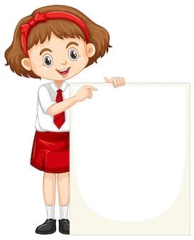 Une fille heureuse avec tableau blanc
