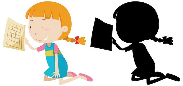 Fille heureuse tenant du papier avec sa silhouette