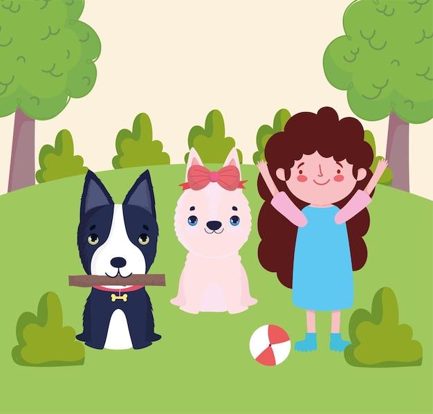 Fille jouant avec ses chiens