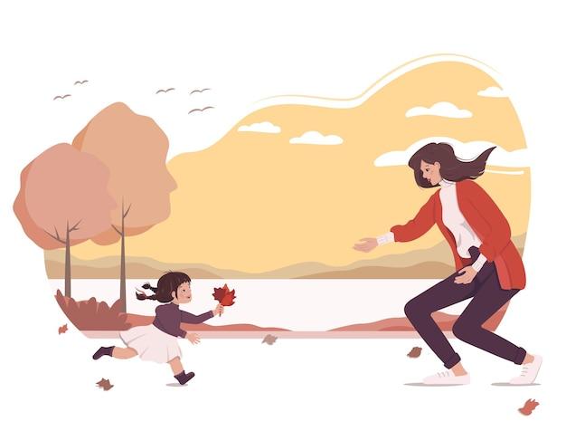 La fille joyeuse apporte à sa mère un bouquet de feuilles. promenade en famille dans le parc avec paysage d'automne. une femme rencontre une fille dans la rue