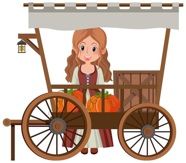 Fille médiévale avec des citrouilles dans un chariot