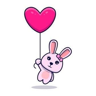 Fille mignonne de lapin flottant avec ballon coeur isolé sur blanc