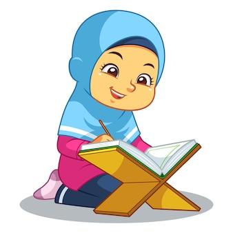 Fille musulmane priant le coran