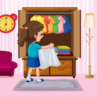 Une fille pliant tissu dans une armoire