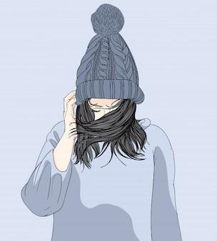 La fille portait un chapeau et son pull en hiver