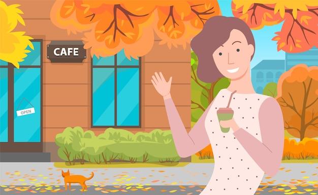 Fille près de café automne feuilles d'or tombent