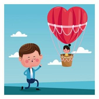 Fille de proposition de garçon battant coeur ballon d'air valentine jour