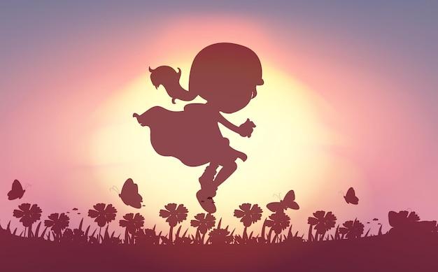 Fille sautant dans le jardin
