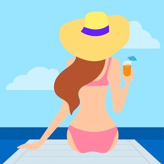 Fille, se détendre sur la plage, boire un cocktail