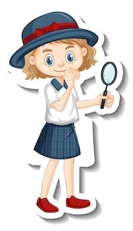 Une fille tenant un autocollant de personnage de dessin animé de loupe