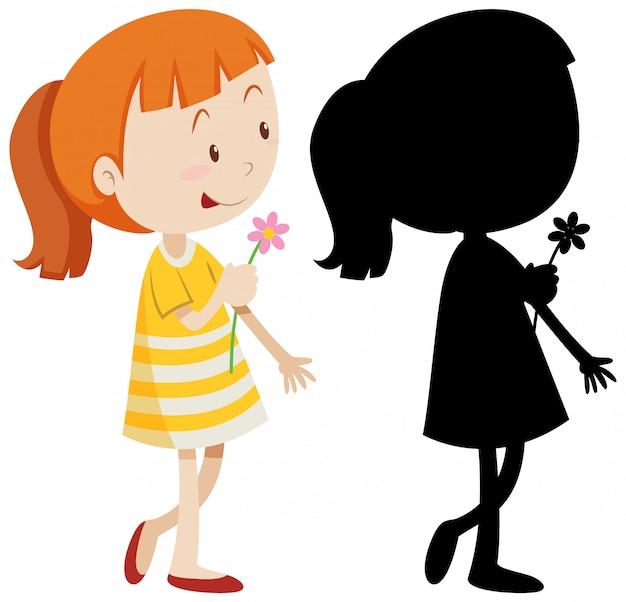 Fille tenant une fleur avec sa silhouette