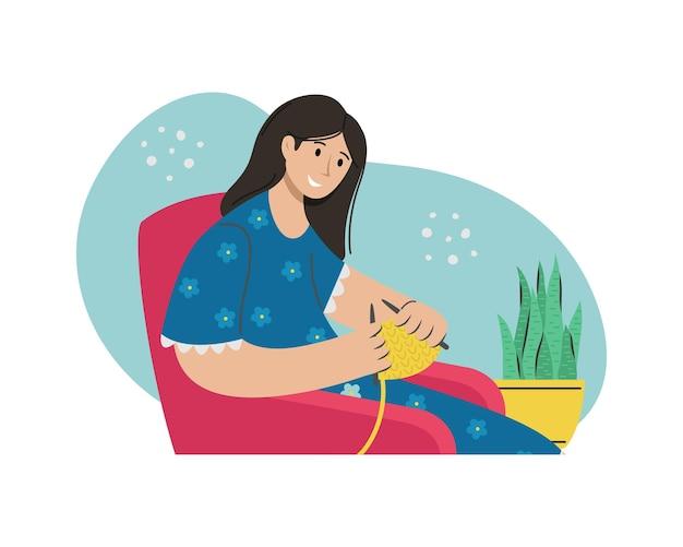 Une fille tricote des vêtements sur une chaise. activité créative.