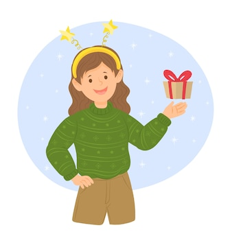 Fille en vêtements chauds tenant une boîte-cadeau