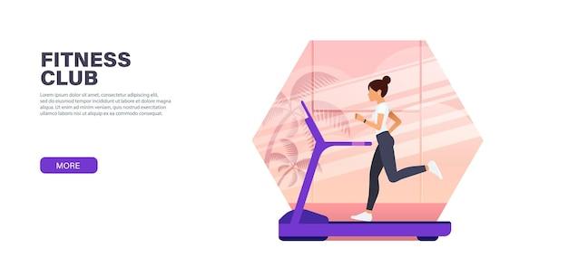 Une fille yang s'entraîne sur un tapis roulant dans un club de sport
