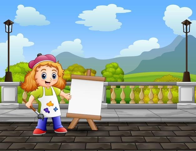 Des filles heureuses peignent des paysages sur une toile
