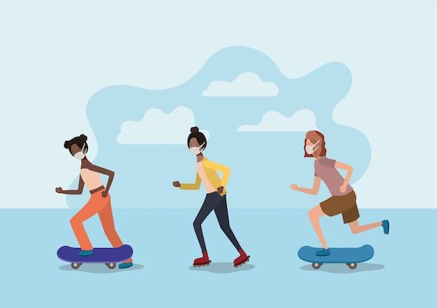 Filles avec des masques sur des planches à roulettes et des patins à roulettes