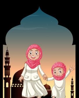 Filles musulmanes tenant par la main