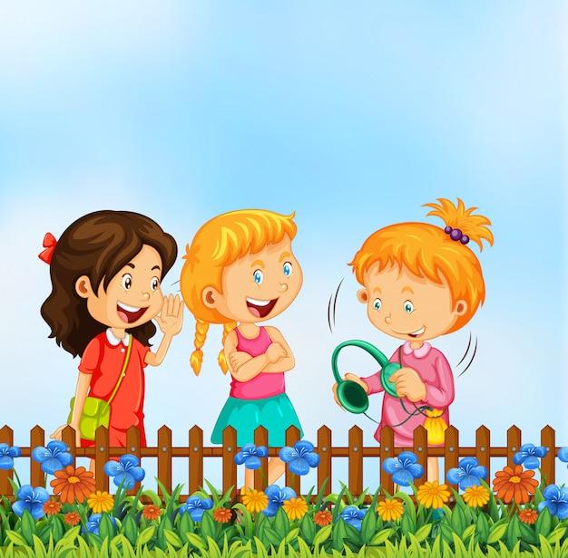 Les filles parlent au jardin
