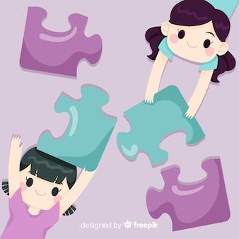 Filles reliant des pièces de puzzle fond