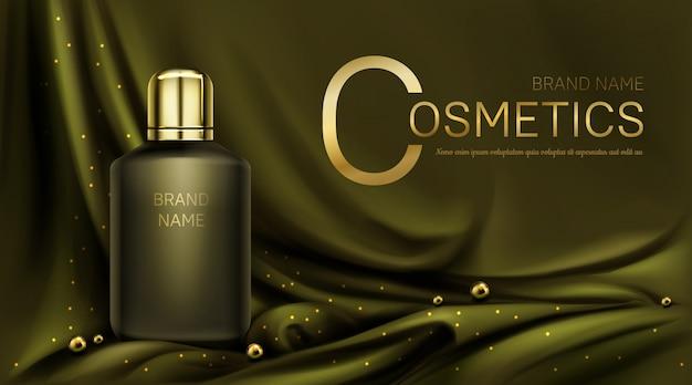 Flacon de parfum sur tissu de soie vert olive plié