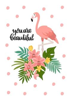 Flamant rose avec des feuilles de fleurs tropicales et la phrase tu es belle