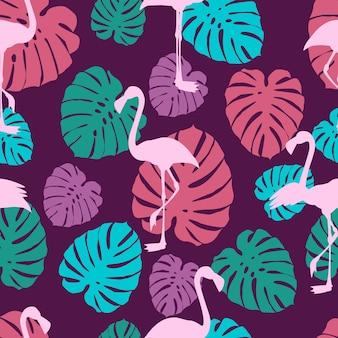 Flamants roses et feuilles tropicales modèle sans couture avec flamants roses et feuilles de monstera