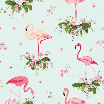 Flamingo bird et fond de fleurs d'orchidées tropicales. modèle sans couture rétro