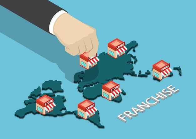 Flat 3d isometric businessman hand a mis le magasin de franchise sur la carte du monde. concept d'entreprise de franchise.