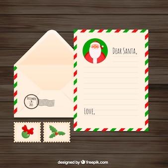 Flat lettre de noël avec des enveloppes et des timbres